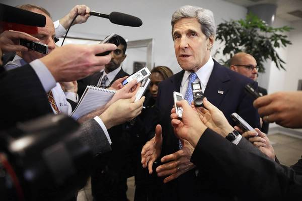 Secretary of State John Kerry speaks with reporters at the Capitol before testifying to the Senate Banking and Urban Affairs Committee behind closed doors Wednesday. Kerry asked Congress not to approve any new sanctions on Iran while negotiations continue with Tehran about its nuclear program.