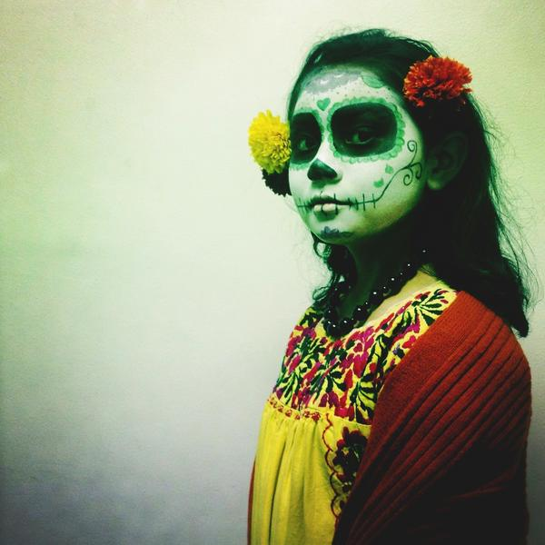 A girl gets dressed up for a Dia de los Muertos event in downtown Los Angeles.