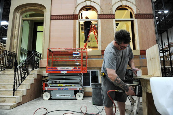 "Construction workers work on building a part of the set of ""House of Cards"" in Joppa, Md., Monday, March 19, 2012. ""House of Cards"" stars Kevin Spacey and Robin Wright."
