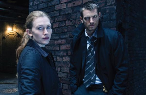 "Mireille Enos and Joel Kinnaman play homicide detectives in ""The Killing."""