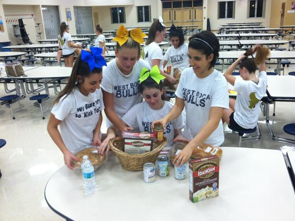 West Boca cheerleaders get together to make baskets to donate to families for Thanksgiving. From left: Nathalie Yacoub, Melissa Bloom, Allie Cohen, Alexa Montemayor