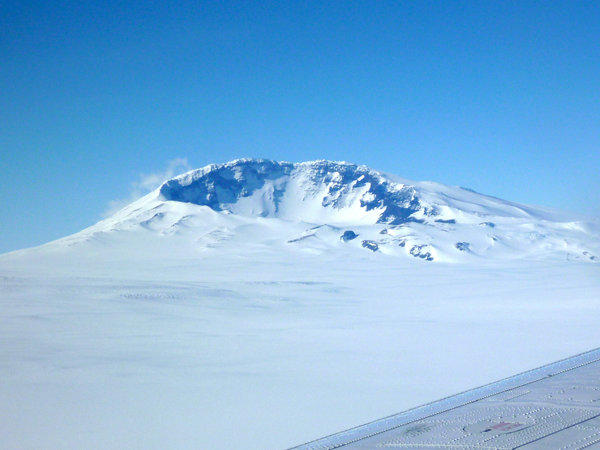 Mt. Sidley is the youngest of a chain of volcanoes looms over the ice sheet in Marie Byrd Land in western Antarctica.