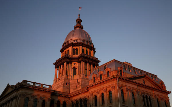 Illinois State Capitol building glows under the setting sun in Springfield, Thursday, Nov. 7, 2013.