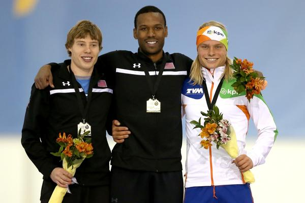 Brian Hansen, Shani Davis and Koen Verweij of the Netherlands pose for photographers on the winner's podium after the men's 1,500 meter during the Essent ISU Long Track World Cup at the Utah Olympic Oval.