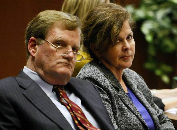Former assistant city manager of Bell, Angela Spaccia, right, and her attorney, Harland Braun, listen to opening statements in her corruption trial in October.