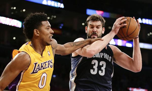 Memphis Grizzlies center Marc Gasol, right, grabs a rebound in front of Lakers forward Nick Young during the first half of Friday's game at Staples Center.