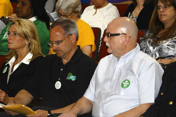 David Delrose, president of AFSCME (American Federation of State, County and Municipal Employees) Local 1028, center, and other Will County employees attended a county board meeting in May to show their support for what they consider a fair contract. Employees have authorized county union leaders to call for a strike vote should contract negotiations break down.