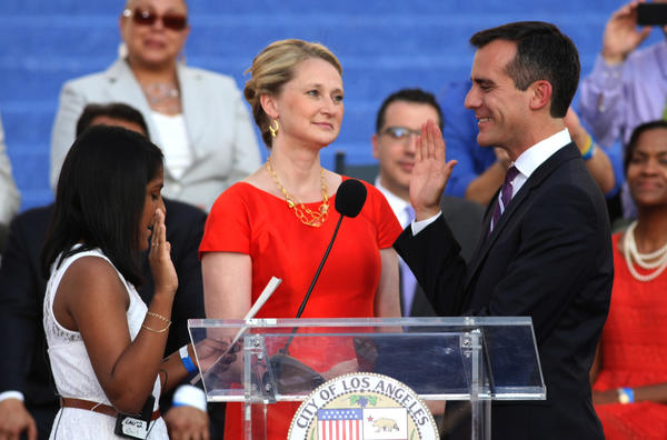 Eric Garcetti and wife, Amy Wakeland, center, during the mayor's swearing-in ceremony, plan to move to Getty House.