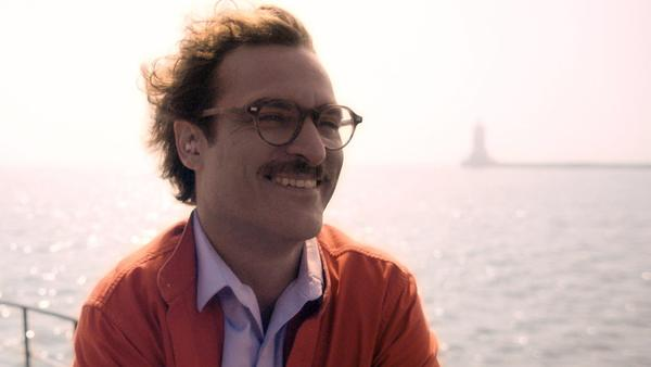 "Joaquin Phoenix's character listens to Scarlett Johansson's voice in ""Her."""