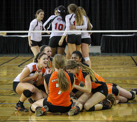 Winter Park players react as they defeat Lake Mary to claim the title in a Class 8A final match during the FHSAA Girls Volleyball Finals at the Silver Spurs Arena in Kissimmee, FLA. on Friday, November 15, 2013. (Joshua C. Cruey, Orlando Sentinel)