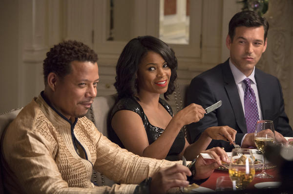 """Terrence Howard, left, Nia Long and Eddie Cibrian in a scene from """"The Best Man Holiday."""""""