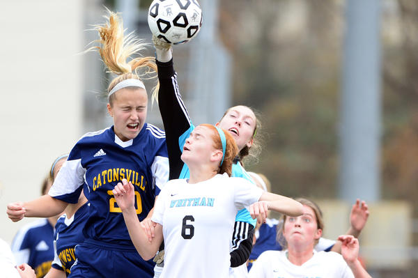 Catonsville's Renee Gast, left, Walt Whitman's Nikki Lane, center, and defenseman Kate Morrison, below, go after a corner kick during the Class 4A state championship