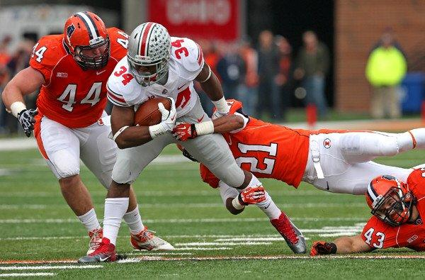 Ohio State running back Carlos Hyde (34) ran through, over and around the Illinois defense for 246 yards on Saturday.