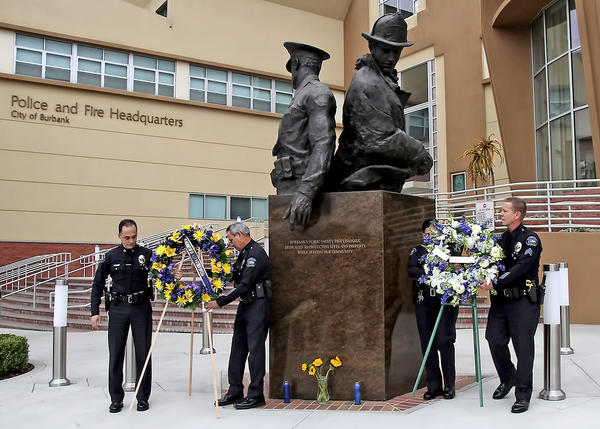 Burbank Police officers lay a wreath in front of the Burbank Police Headquarters on the 10 year anniversary of Burbank Police officer Matthew Pavelka's death.