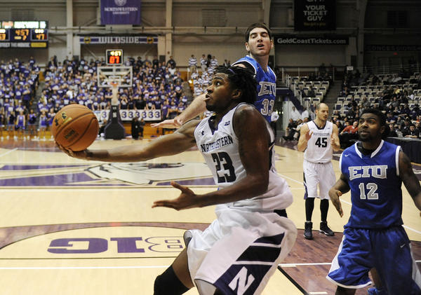 JerShon Cobb is defended by Eastern Illinois' Luke Piotrowski during the second half at Welsh-Ryan Arena.