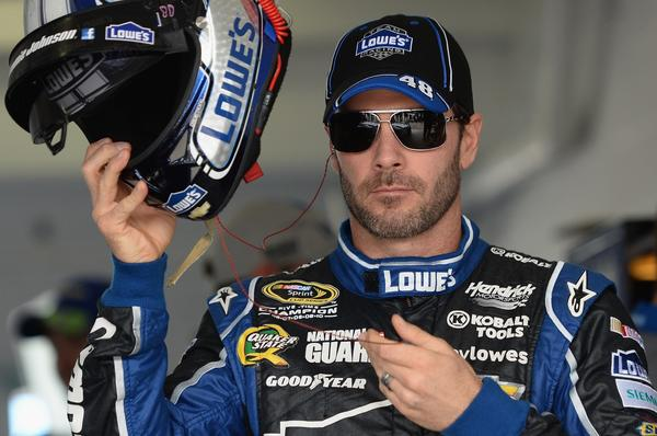 Jimmie Johnson, driver of the #48 Lowe's/Kobalt Tools Chevrolet, stands in the garage area during practice for the NASCAR Sprint Cup Series Ford EcoBoost 400 at Homestead-Miami Speedway.