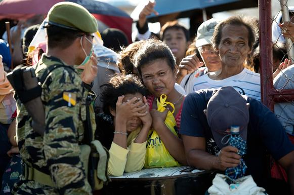 Residents wait to be evacuated at the airport in Tacloban, Philippines, which was devastated by Typhoon Haiyan.