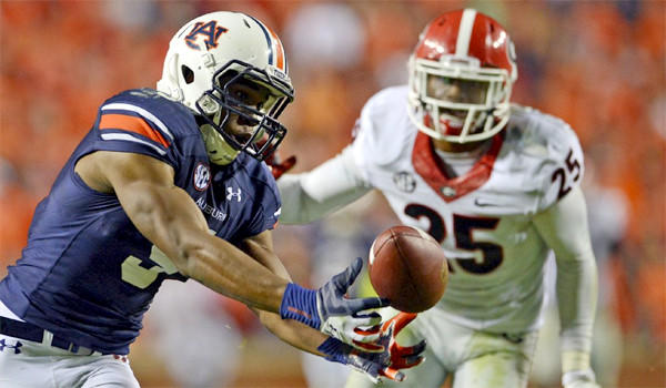 Auburn receiver Ricardo Louis makes an improbable catch against Georgia after Bulldogs defenders failed to corral an underthrown pass and it fell into Louis' waiting hands for a 73-yard game-winning touchdown.