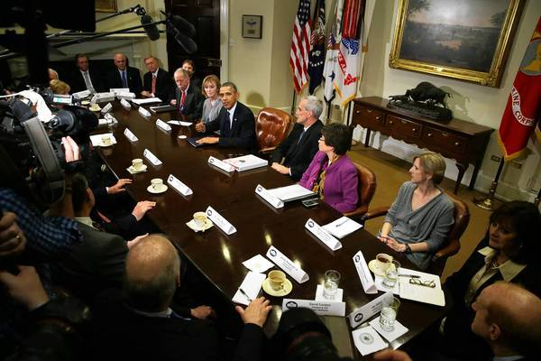 President Obama meets with health insurance executives in the Roosevelt Room at the White House.