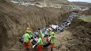 Philippine city overwhelmed by task of burying typhoon victims