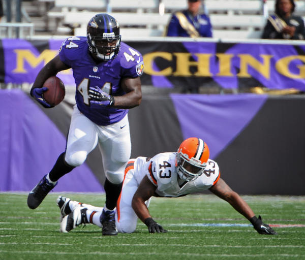 Ravens fullback Vonta Leach rumbles past the Browns' T.J. Ward for a 12-yard gain in the third quarter of their September meeting.
