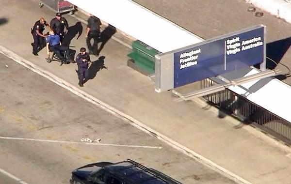 This frame grab shows a wounded TSA agent being rushed to an ambulance after the Nov. 1 shooting at LAX.
