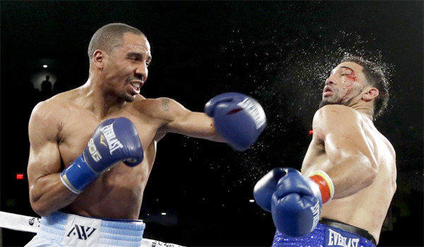 Andre Ward connects with a left to Edwin Rodriguez during the 12th round of their super-middleweight title boxing match at Citizens Business Bank Arena in Ontario, Calif. Ward won by unanimous decision, retaining his title.