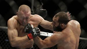 UFC 167: Georges St-Pierre beats Johny Hendricks; to take time off