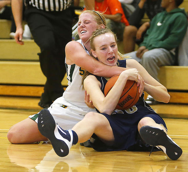 Presentation College's Sydney Larson, left, ties up the ball and College of Saint Mary's Tiffany Anzalone, right, in the second half of Saturday's game at the Strode Activity Center. photo by john davis taken 11/16/2013