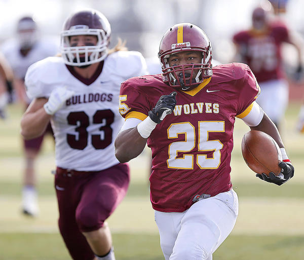 Northern State University's Terrelle Walker, right, sprints down the sideline on a 79-yard run ahead of University of Minnesota-Duluth's Nathan Zibolski (33) in the first half of Saturday's game at Swisher Field. photo by john davis taken 11/16/2013