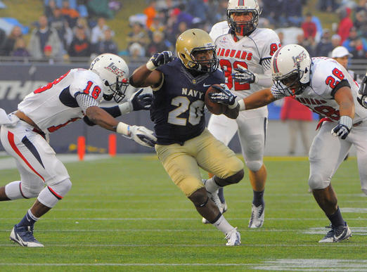 South Alabama's Terrell Brigham (18) and Enrique Williams (28) close in on Navy's Darius Staten (20).