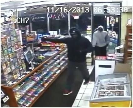 This surveillance image shows the men wanted in connection with the robbery of a gas station in Southington Saturday night.
