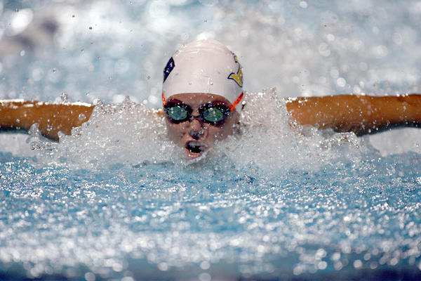 Mia Fiorenzi of St. Thomas Aquinas competes at state Class 4A swim meet.
