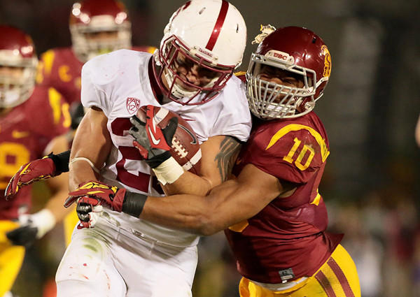 USC linebacker Hayes Pullard brings down Stanford running back Tyler Gaffney during their sold-out Pac-12 Conference game Saturday night at the Coliseum.