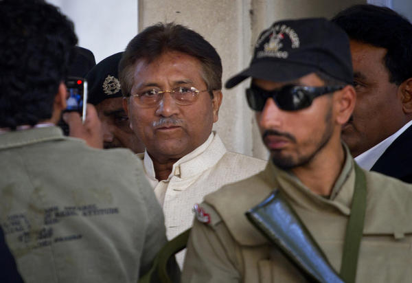 Pakistan's former president and military ruler Gen. Pervez Musharraf, center, leaves after appearing in court in Rawalpindi, Pakistan, in April.