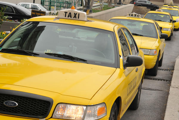 Taxis lined up outside of Penn Station. A group of taxi, limo, and sedan-for-hire services say they will refuse to pay a new city tax on taxi trips in the city, which went into effect on Oct. 1. The first taxes are due on Nov. 26.