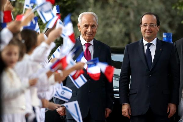 French President Francois Hollande (right) and Israeli President Shimon Peres are shown during a welcome ceremony Sunday at the Israeli president's residence in Jerusalem.