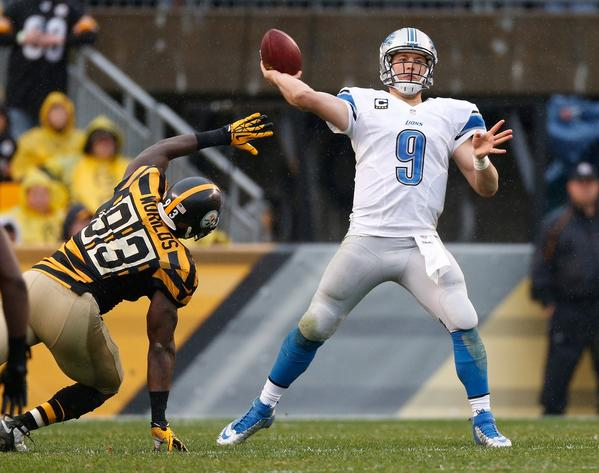 Lions QB Matthew Stafford throws a second quarter touchdown pass while being pressured by the Steelers' Jason Worilds.