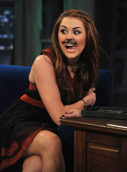 "Miley Cyrus rocks a mustache in 2011 on ""Late Night with Jimmy Fallon."""