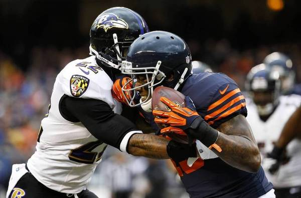 Bears wide receiver Brandon Marshall fights for yards after a catch against Baltimore on Sunday.