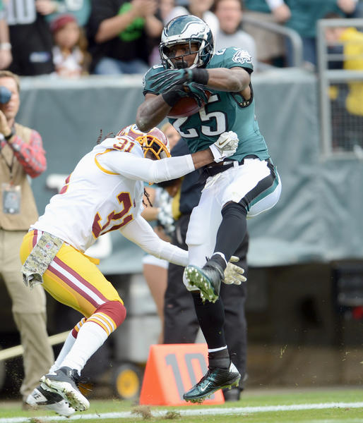 Philadelphia Eagles running back LeSean McCoy (25) hops by Washington Redskins strong safety Brandon Meriweather (31) at Lincoln Financial Field in Philadelphia on Sunday.