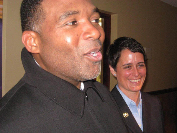 The Rev. Donte Hickman and Del. Heather R. Mizeur greet parishioners at Southern Baptist Church.