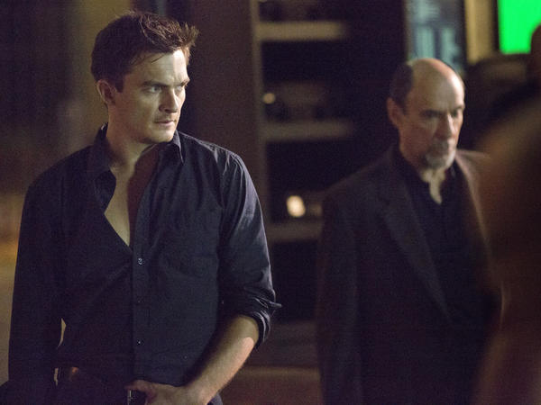 "Rupert Friend as Peter Quinn and F. Murray Abraham as Dar Adal in ""Homeland."""