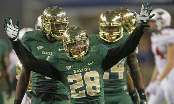 Baylor safety Orion Stewart celebrates a defensive stop during Saturday's 63-34 win over Texas Tech. The Bears will look to upset Oklahoma State on Saturday.