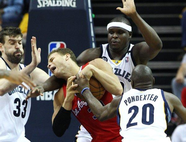 Clippers power forward Blake Griffin is fouled while trying to make a move in the lane against a trio of Grizzlies defenders (from left): center Marc Gasol, power forward Zach Randolph and forward Quincy Pondexter during a game last season.