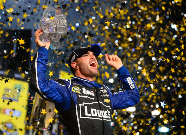 NASCAR Sprint Cup Series driver Jimmie Johnson celebrates in victory lane after winning the Sprint Cup championship after the Ford EcoBoost 400 at Homestead-Miami Speedway.