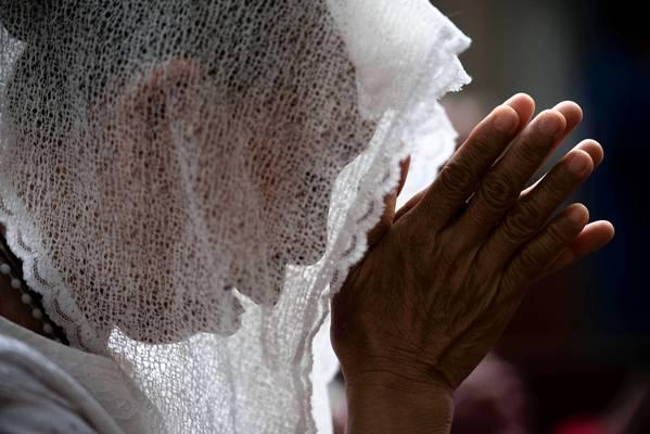 A typhoon victim prays at Santo Niño Church in Tacloban, Philippines.