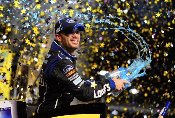 NASCAR Sprint Cup Series driver Jimmie Johnson celebrates after winning the Sprint Cup championship after the Ford EcoBoost 400 at Homestead-Miami Speedway.