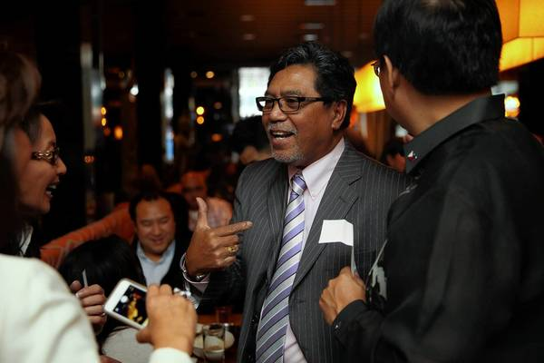 Businessman Bernie Bernasol attends a Typhoon Haiyan fundraiser on Friday at Sunda in Chicago. He plans to return to his native country, the Philippines, and help people there recover.