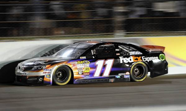 Denny Hamlin races down the straightaway en route to victory Sunday at the Ford EcoBoost 400.